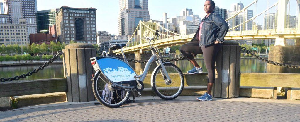 Bike Pittsburgh. African American Women riding a bike.
