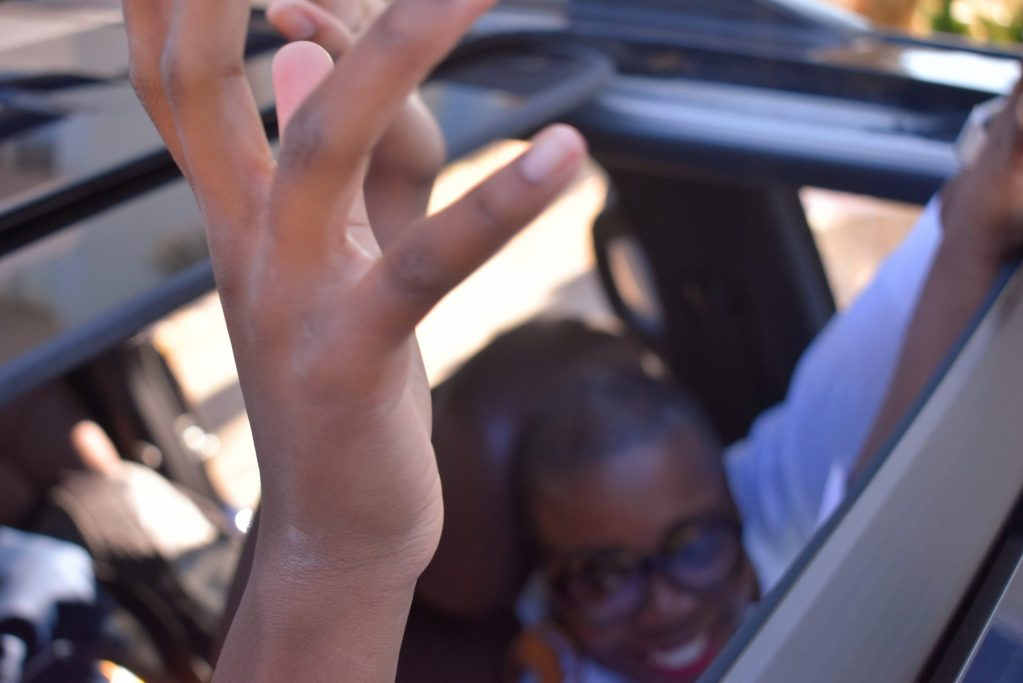 Spirit fingers in the Toyota Landcruiser moonroof on the long family road trip.