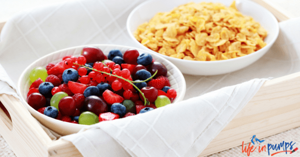 Bowl of fruit and healthy cereal to eat for breakfast.