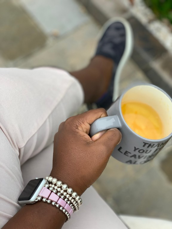 drinking tea alone with Lagos bracelet and rothys