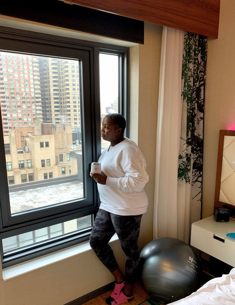 brown girl looking out window contemplating exercising for better diabetes health