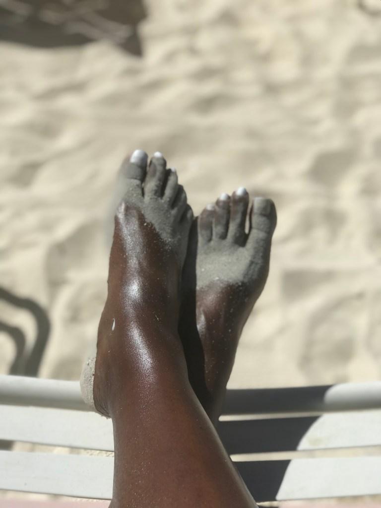 black girl feet in sand