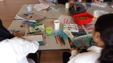 Participants working on various art pieces.