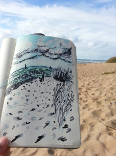 felt tip sketch drawing of sandy beach with real beach in the background