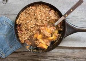 skillet of fresh peach crisp