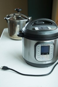 new and old pressure cookers