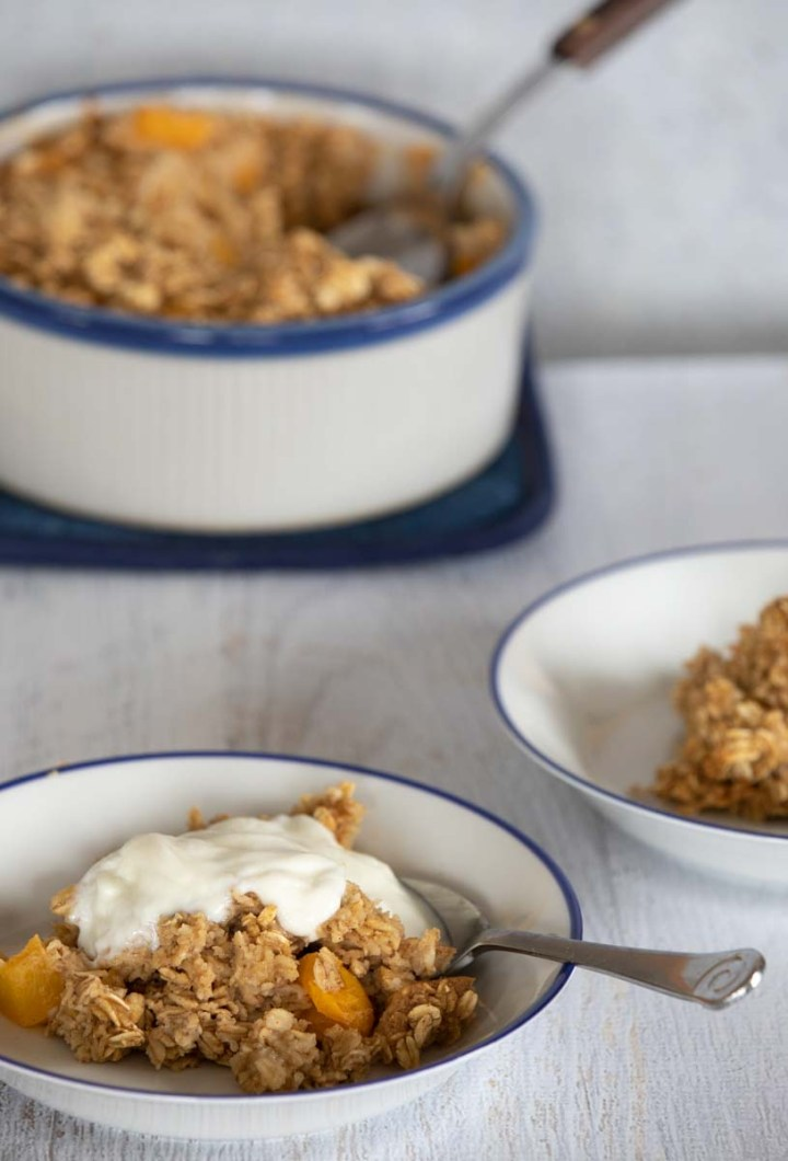 Bowls of hot oatmeal with yogurt topping