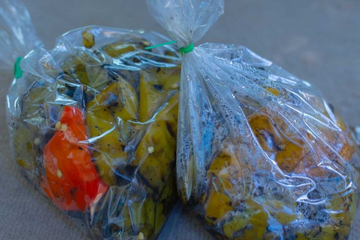 roasted chiles sweating in plastic bags