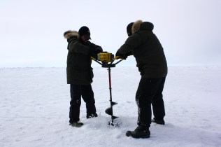 Andy and Craig using the auger.