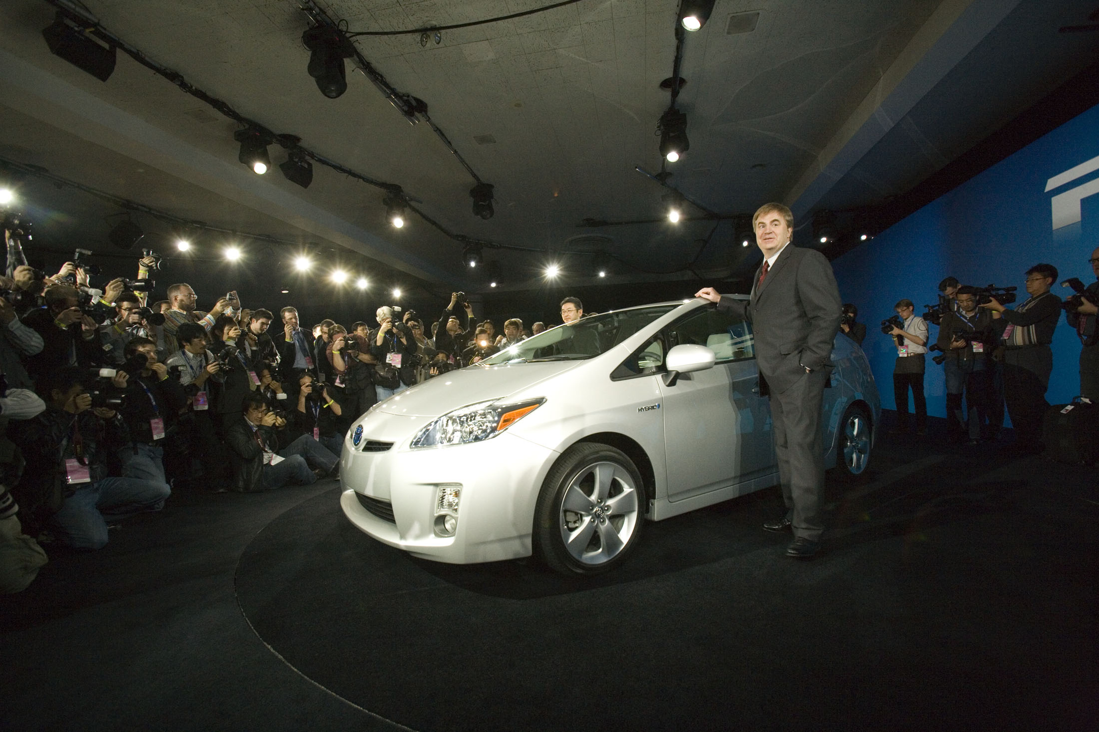 Akihiko Otsuka, (L)chief engineer and Bob Carter, group vice president and general manager of Toyota after the third-generation 2010 Toyota Prius hybrid made its world debut at the North American International Auto Show.