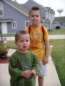 Eldest's first day of kindergarten c. 2004 (and Youngest wearing one of Eldest's new shirts and getting the news that he does not get to go to school).