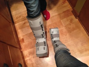 Eldest got his boot out to show me how to walk properly. How can you not find joy in looking at the size difference between them?