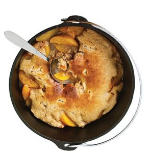 Camping Meals for Dinner and Dessert at LifeInTheNerddom.com - Dutch Oven Peach Cobbler Courtesy of My Recipes