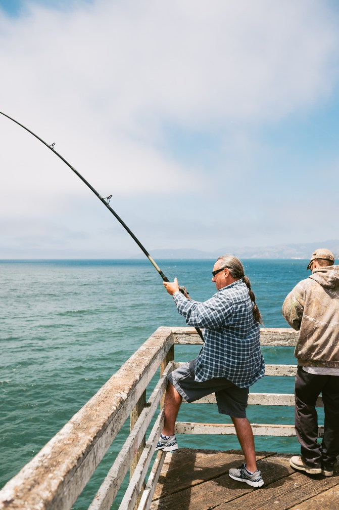 This man just caught a shark as I walked on the pier. Pismo Beach, CA.