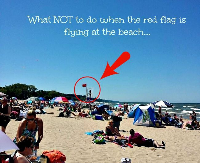 What NOT to do when the red flag is flying at the beach....