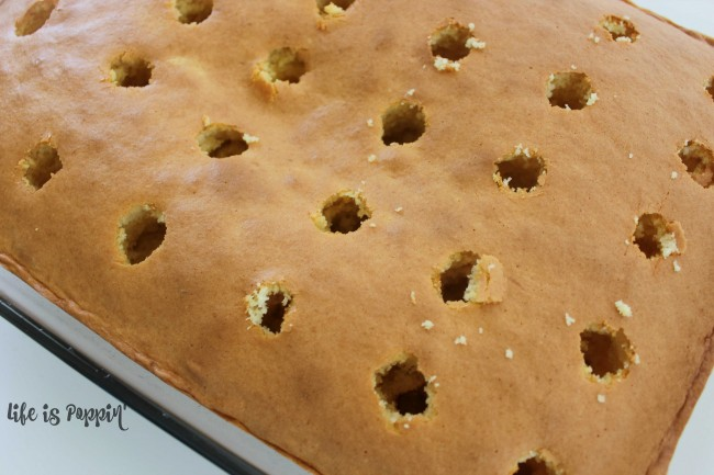 Boston Cream Poke Cake - poke holes