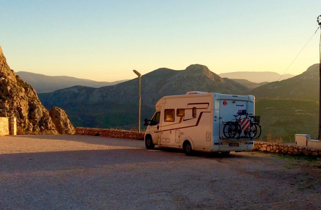Campervan parked at the Acorcorinth carpark looking out and down over the surrounding valleys