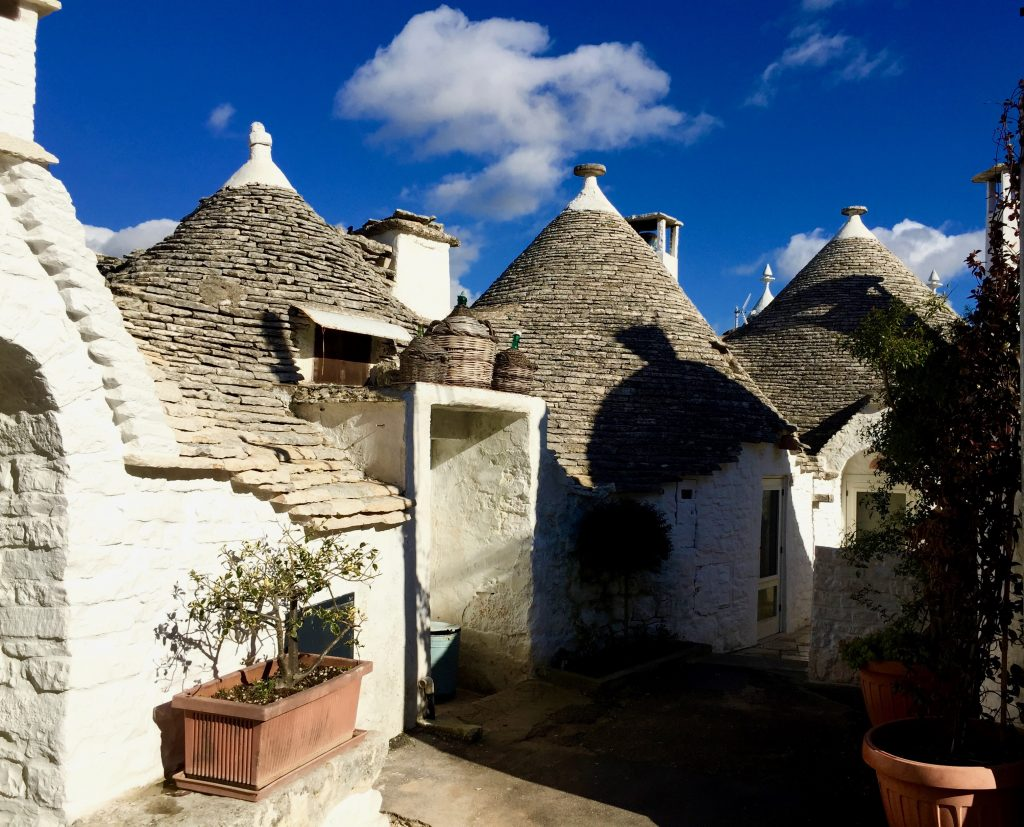 Three little trulli houses in the Aio Piccola district of Alberobello