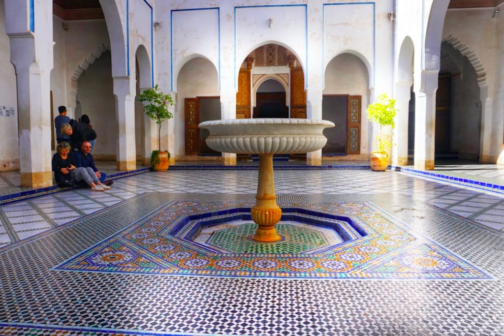Central fountain with different coloured tiles being all symmetrical
