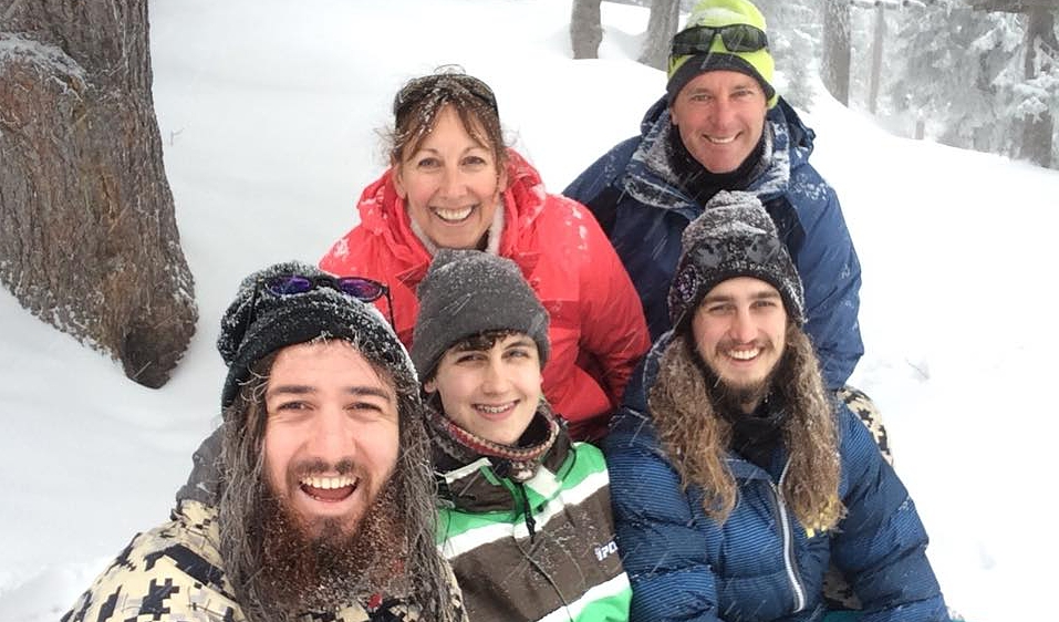 Family photo of Michelle and Lars with her three boys. in the snow