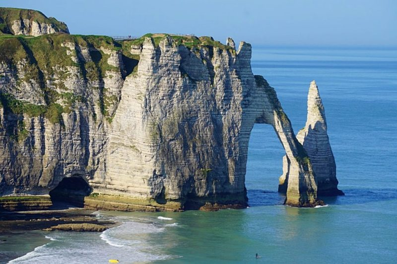 white limestone needle-like formations in the sea off Etretat, Normandy