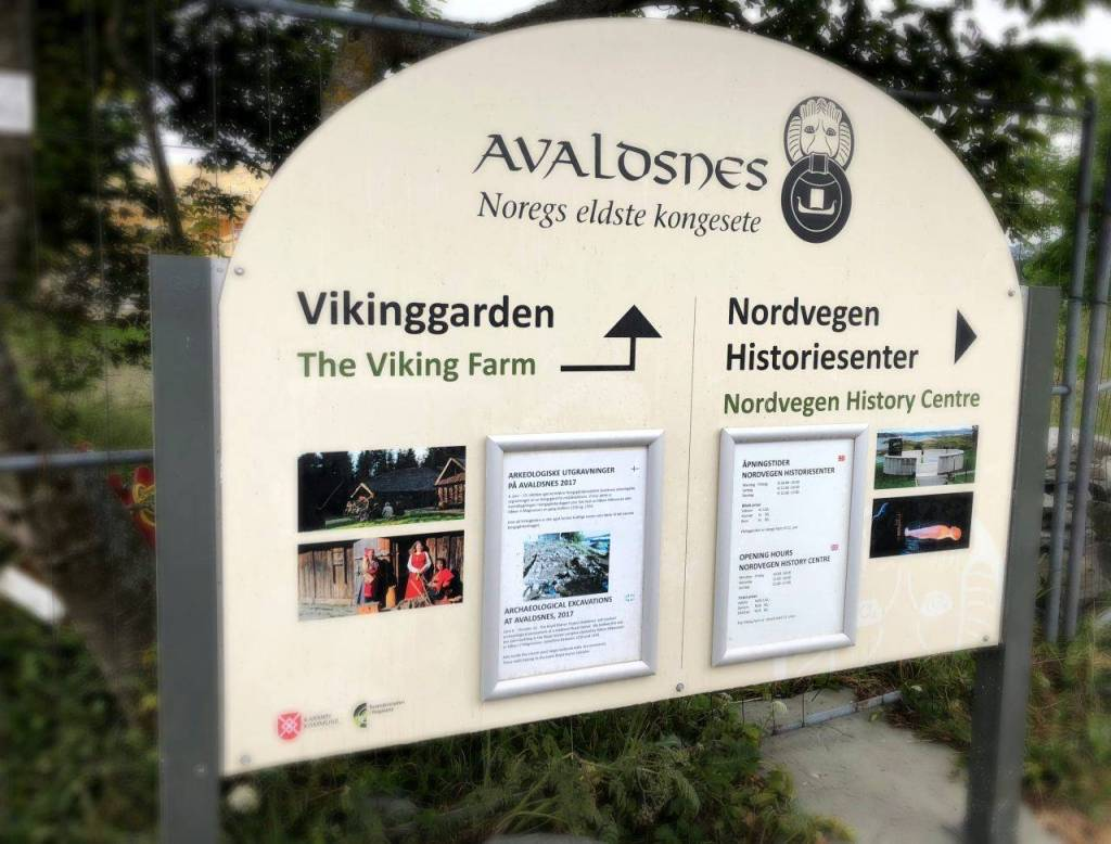 Sign at the homeland of the viking kings showing the way to the history centre and the viking farm