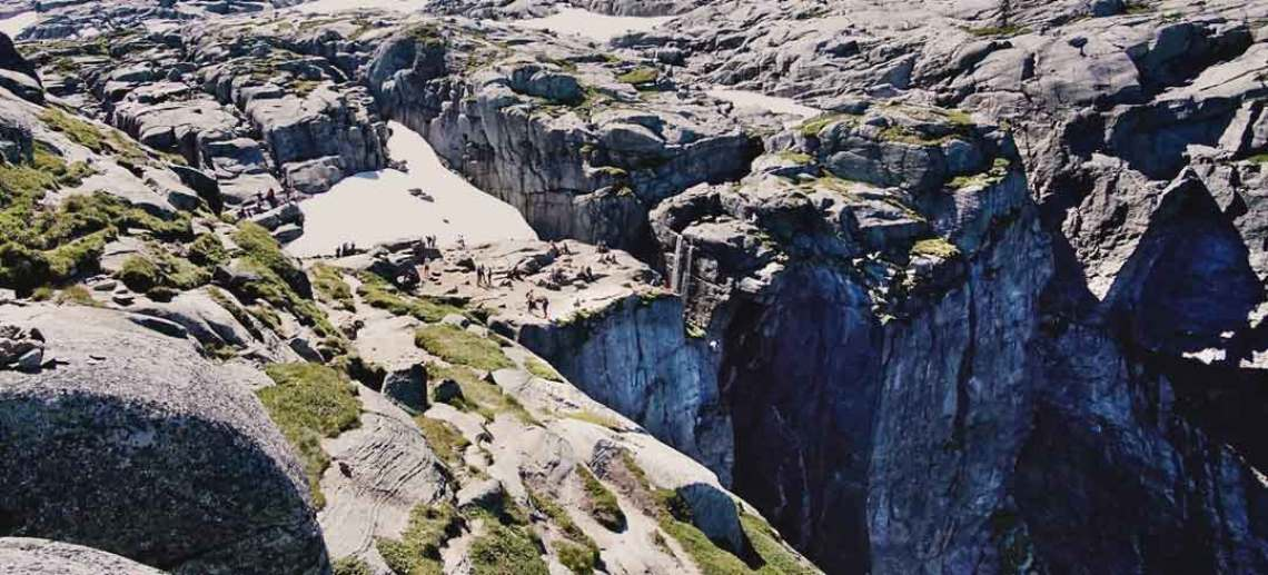 A view overlooking the top of Kjerag - a plateau of rock but over the edge is a 1000 metre drop