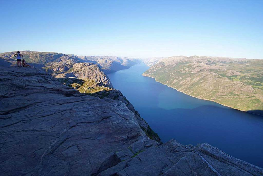 View from Preikestolen of the blue fjord water and surrounding countryside
