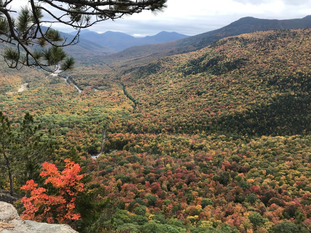 A beautiful mountain scenery with changing leaves seen from the top of Frankenstein Cliff near Jackson, NH.