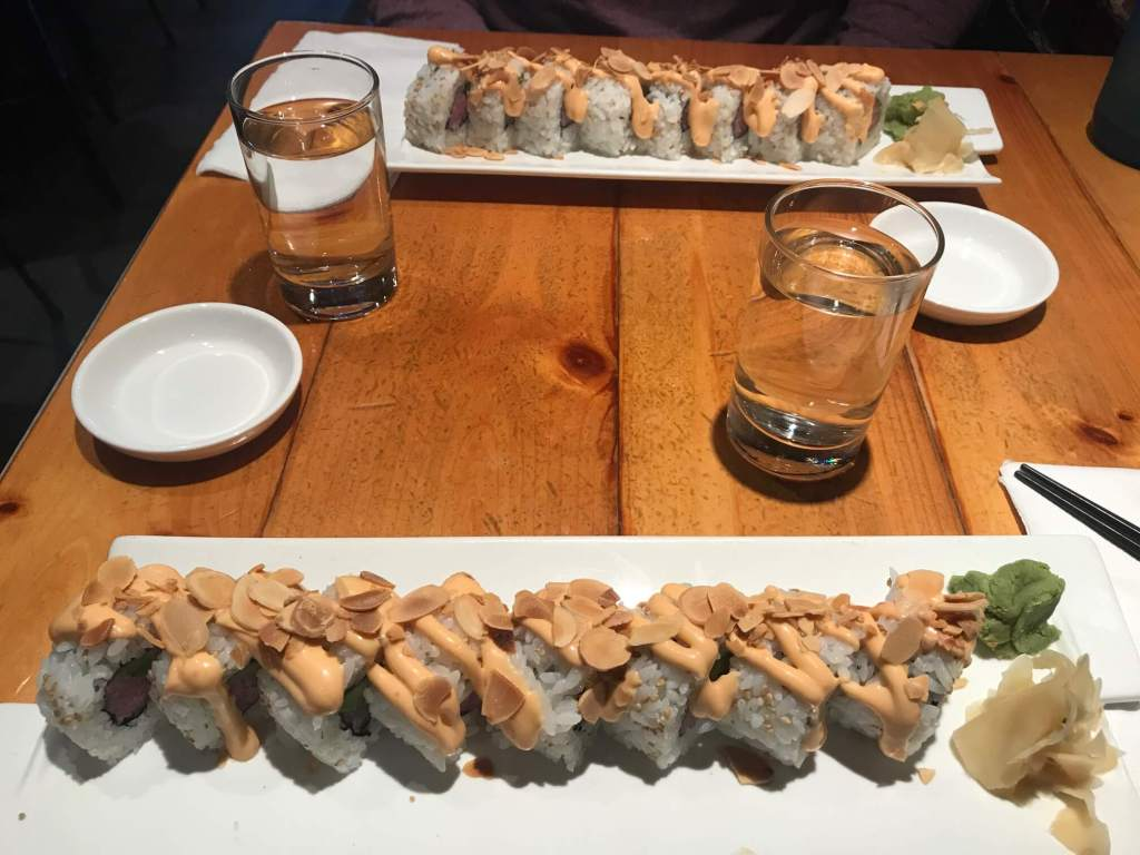 Rolls of sushi on a table at Pai Men Miyake in Portland, Maine.