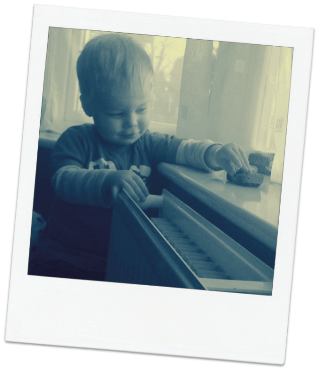Image of child playing with cars