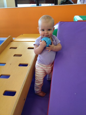 Practicing her standing at Gymboree in North Vancouver