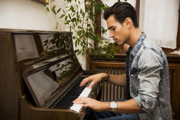 Creativ Music Centre man playing piano