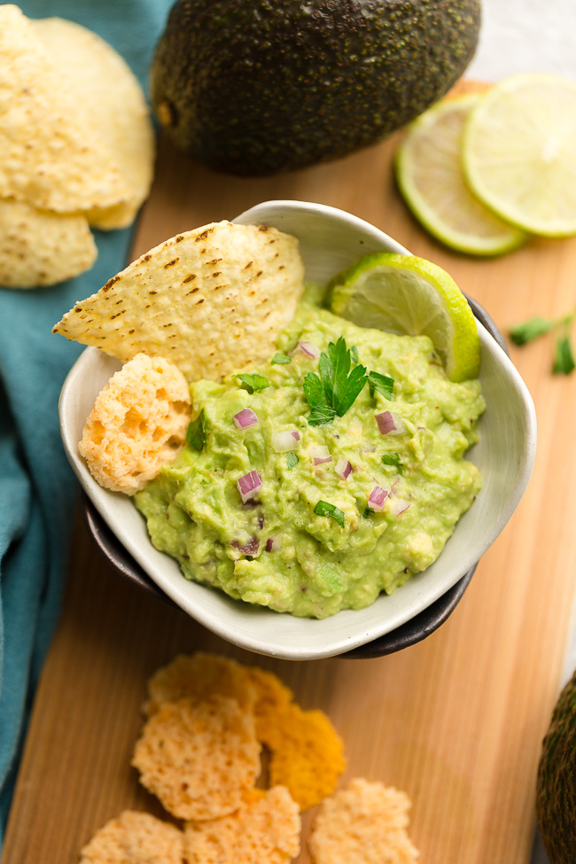 Low Carb Guacamole - this homemade recipe is the perfect party dip and keto, paleo and Whole 30 snack. Pairs perfect with fajitas, salads or by the spoonful.