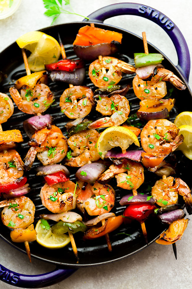 Grilled Lemon Shrimp Skewers with Vegetables coated with a buttery garlic lemon sauce. Low carb, keto and perfect for patio season.