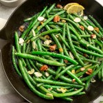 Top view of skillet green beans in a cast iron skillet