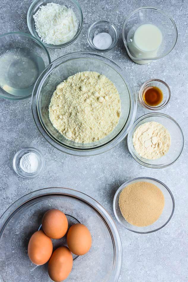 Ingredients for almond flour keto pancakes on a grey background