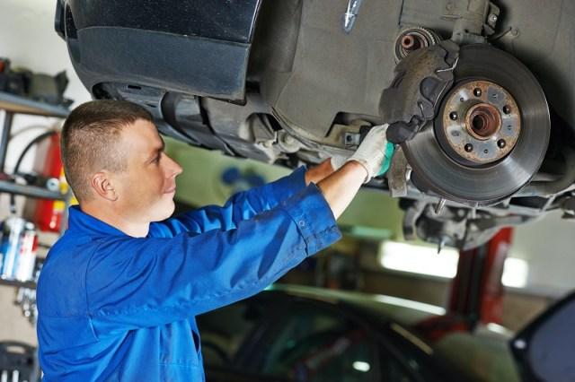 Man working on car breaks.