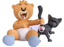 Dum Dum is a baby bear figurine, placing their dummy up a cat's bum.