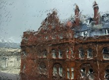 Midland Hotel distorted by heavy rain on a window