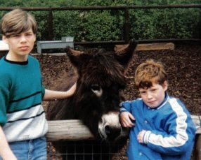 My brother and I posing with a donkey