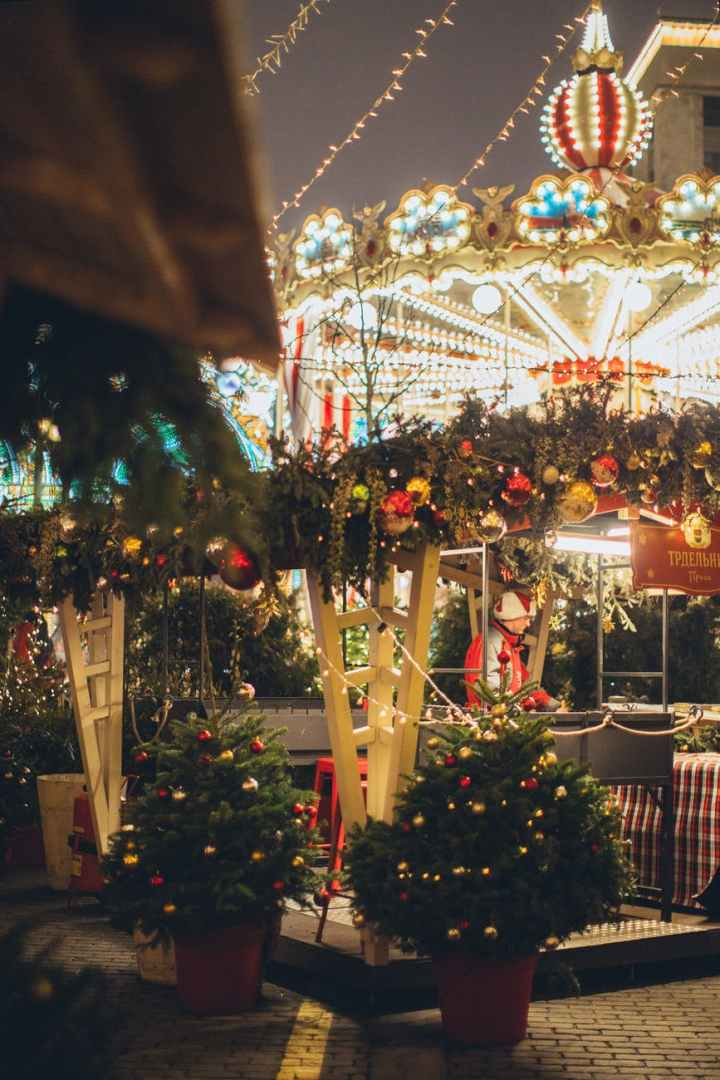 illuminated carousel in amusement park in evening