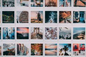 assorted photos on white wooden shelf