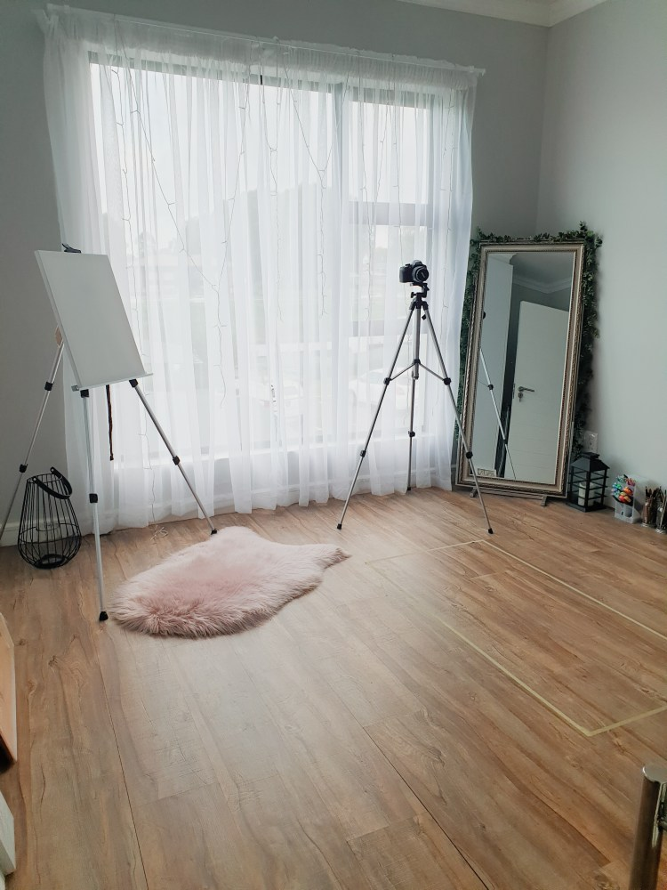 art studio with pink carpet and white curtains, simple art studio design