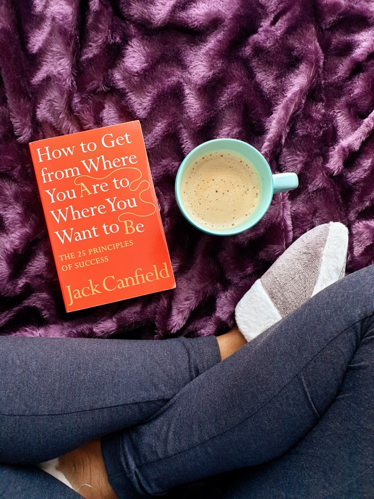 cup of coffee, rug and book, jack canfield book, bedroom slippers