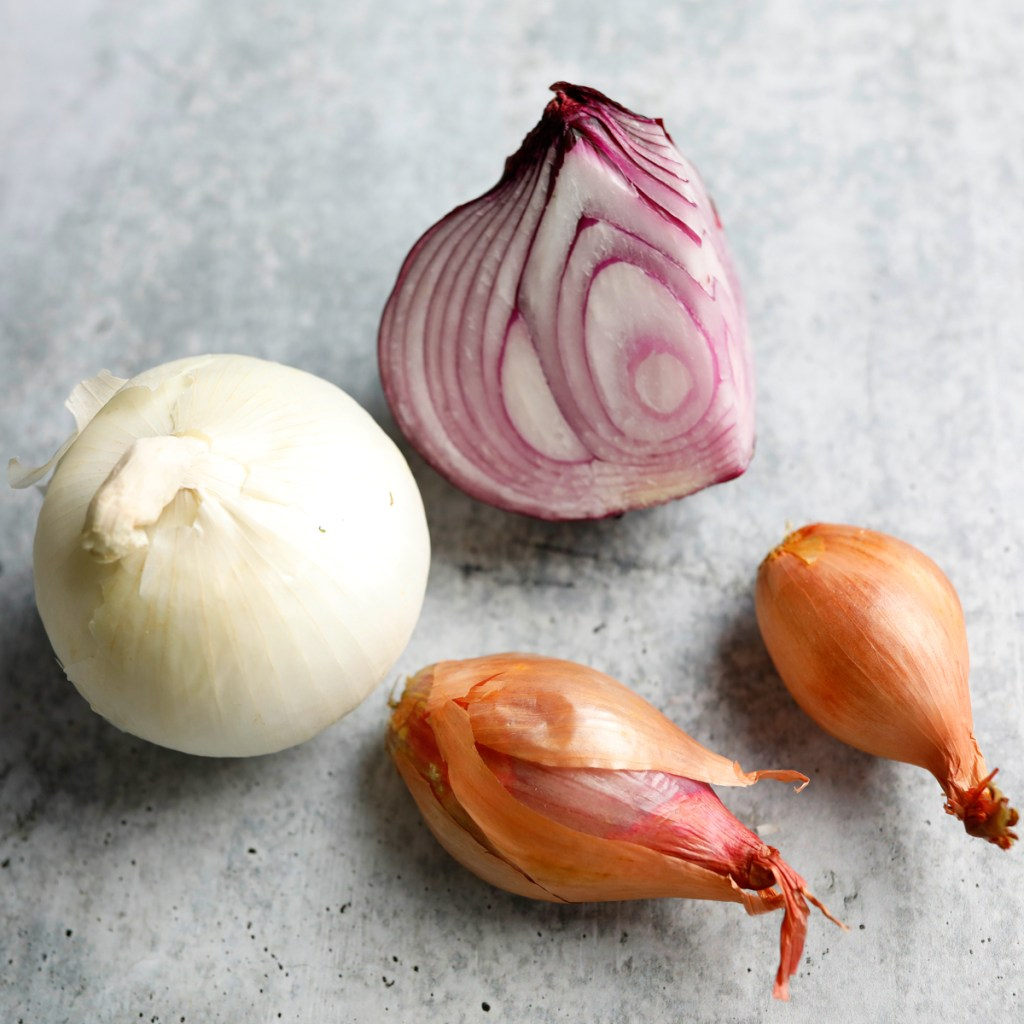 Onions and shallots are all part of the allium family, shallots are slightly sweeter and less pungent.  I often use shallots instead of onions for my personal taste.