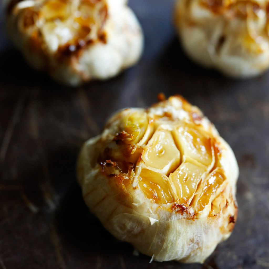 Roasted garlic is a treat! Cut off the tops, drizzle with olive oil, wrap in foil and roast in over 45 minutes at 425 degrees fahrenheit.  This is a great way to increase the health benefits of dishes you are cooking.