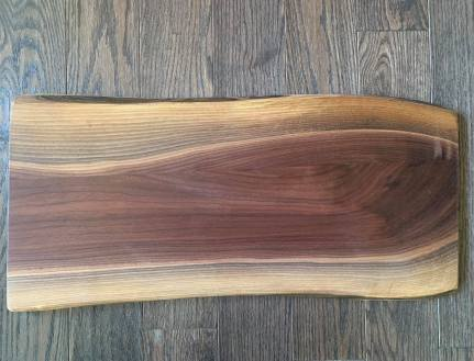 Walnut wood charcuterie/serving board with personalized engraving and handles 25 by 11 inches $180