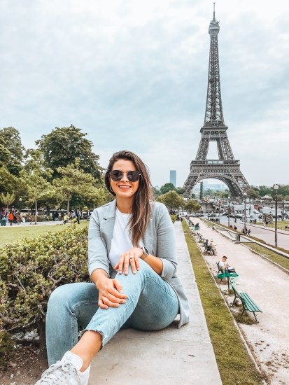 Girl sitting across Eiffel Tower