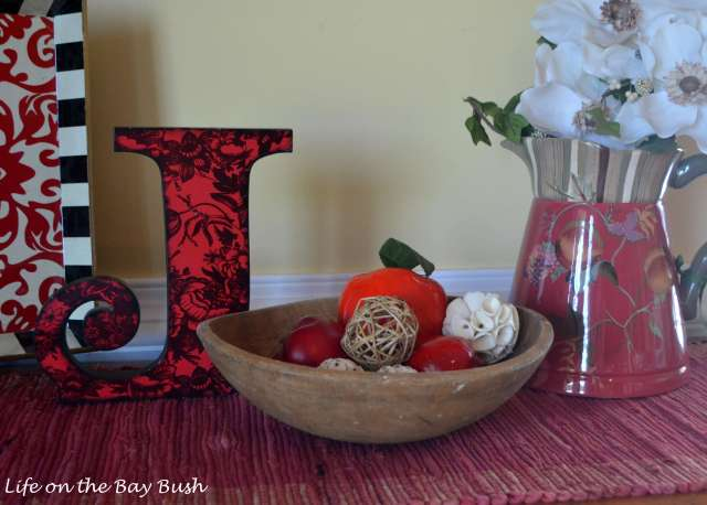 I-love-incorporating-dough-bowls-into-my-decor!-I-filled-this-small-antique-dough-bowl-that-belonged-to-my-grandmother-with-faux-apples-and-decorative-filler.-I-can't-wait-to-add-a-pumpkin-this-fall!